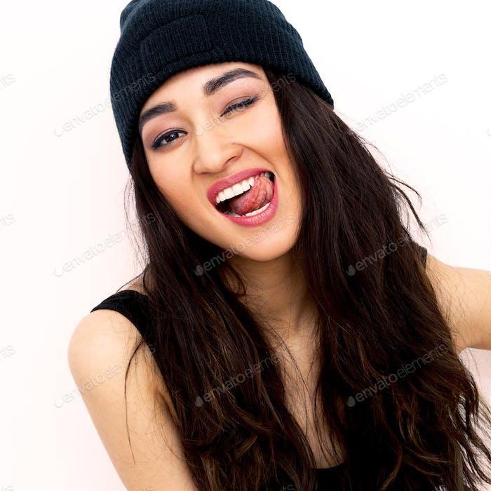 Sexy brunette Girl in black beanie cap. Swag rap style