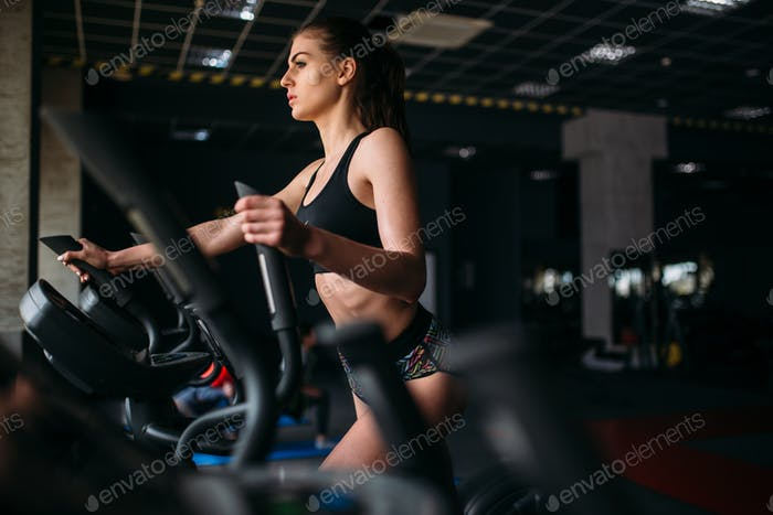 Female athlete exercise on treadmill in sport gym