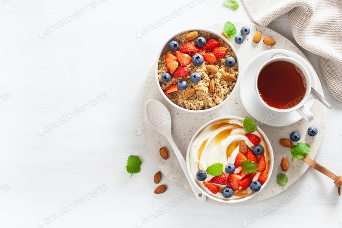 yogurt with strawberry blueberry honey almond and quinoa for bre
