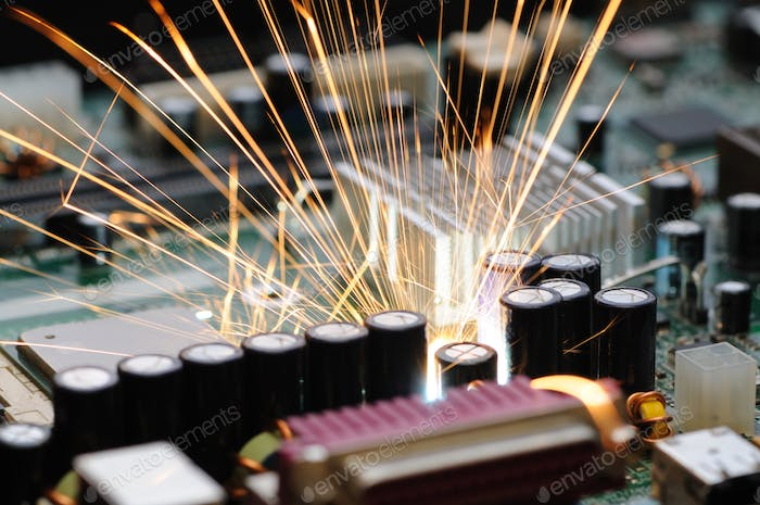 Burning sparks fly from a circuit chip