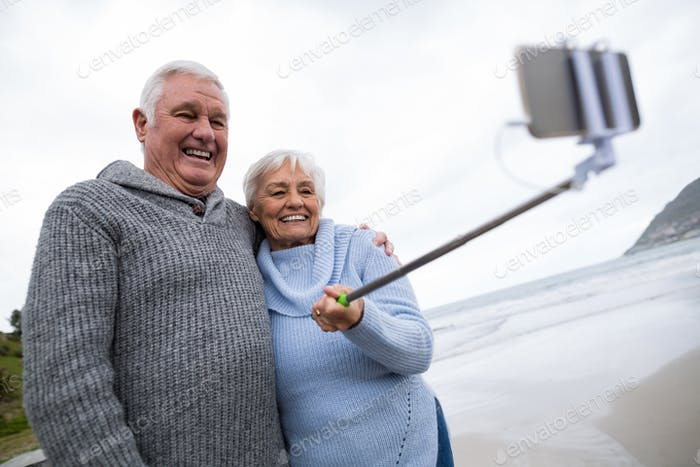 Senior couple taking a selfie from selfie stick