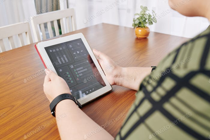 Woman using smart home application