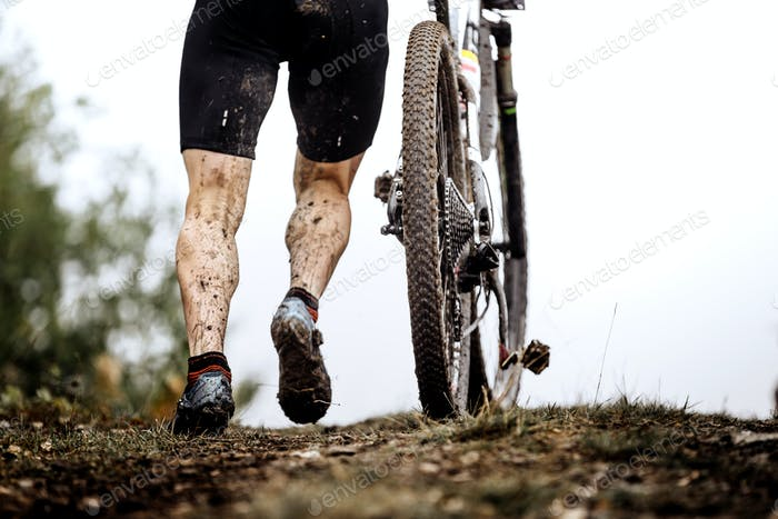 closeup dirty feet athlete mountainbiker