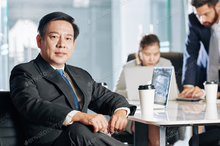 Confident Vietnamese entrepreneur