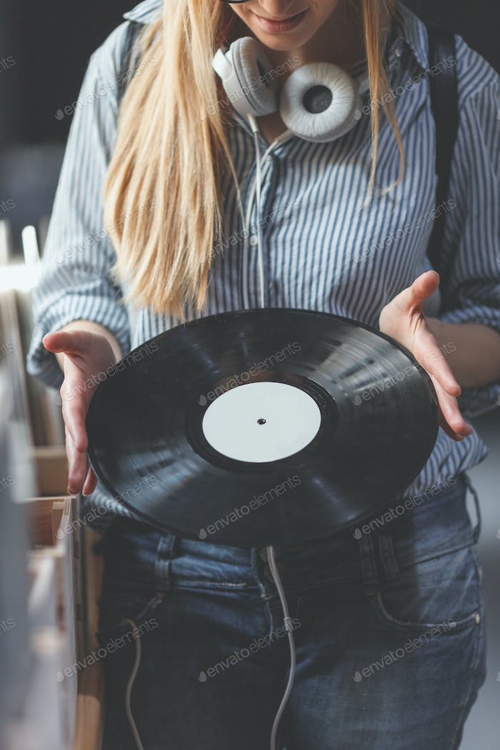 Young woman with music records