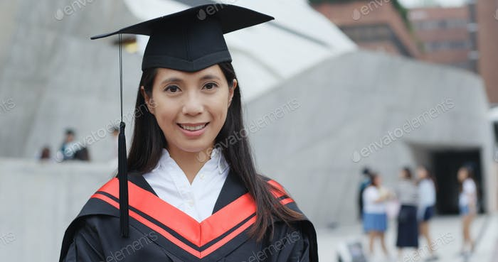 Confident woman graduation in university
