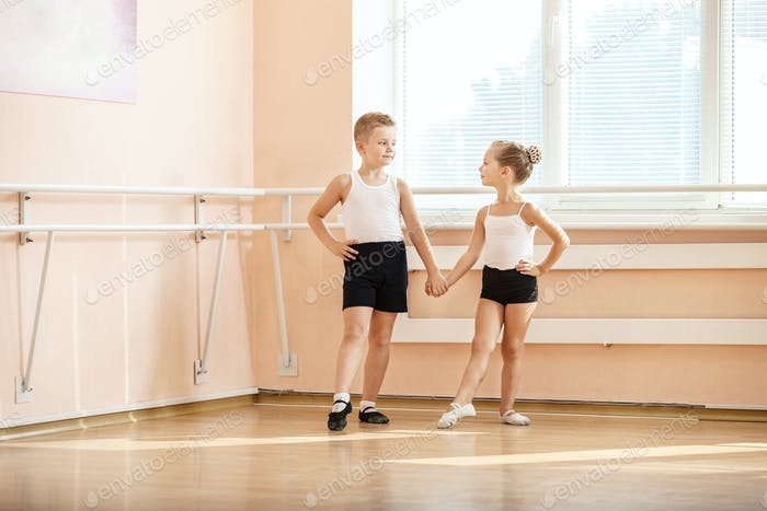 Young boy and a girl dancing at ballet class