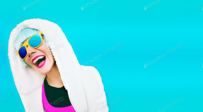 Positive girl on bright blue background. winter Style