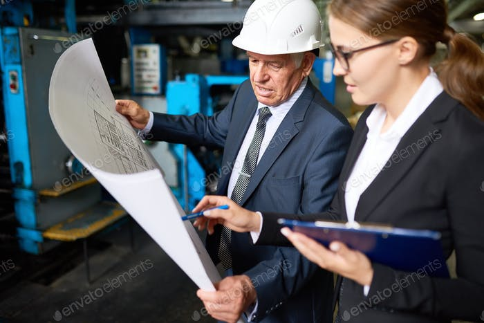 Senior Manager Discussing  Factory Plans