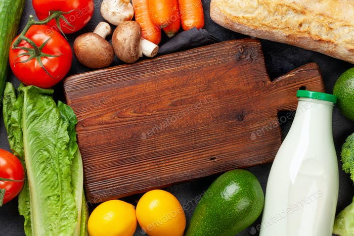 Various vegetables, fruits and and cutting board