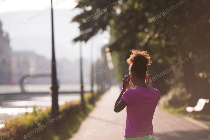 portrait of young african american jogging woman