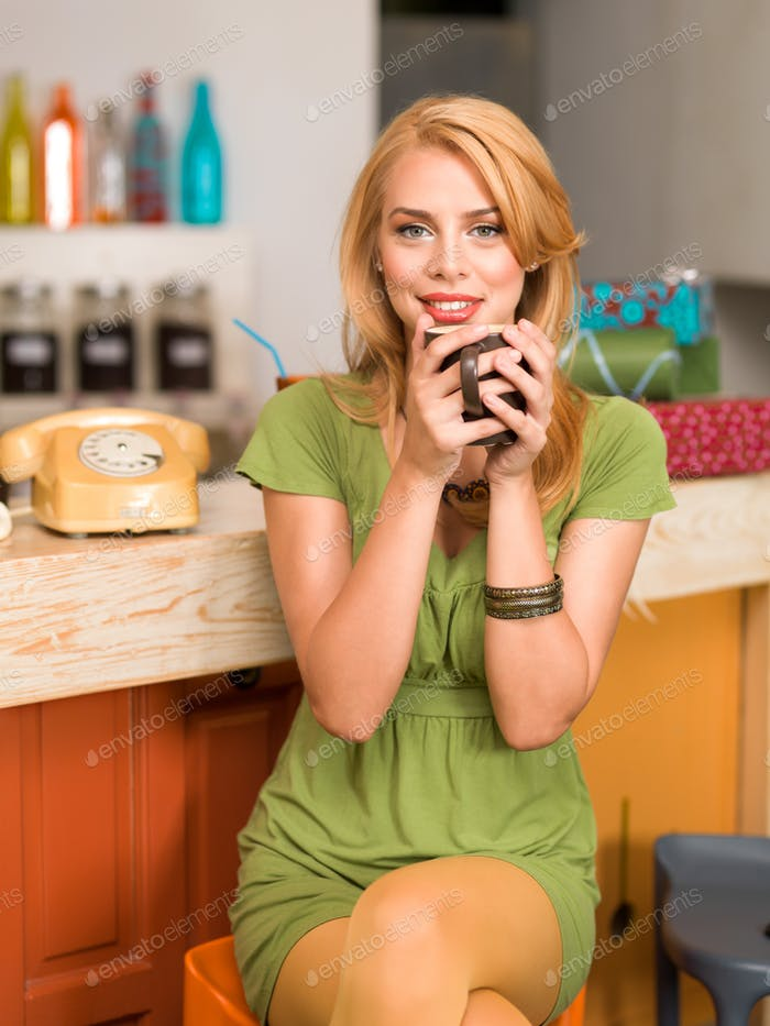 beautiful young girl with a coffee mug