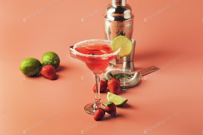 Strawberry red margarita alcoholic cocktail with tequila, liqueur, berries, lime juice