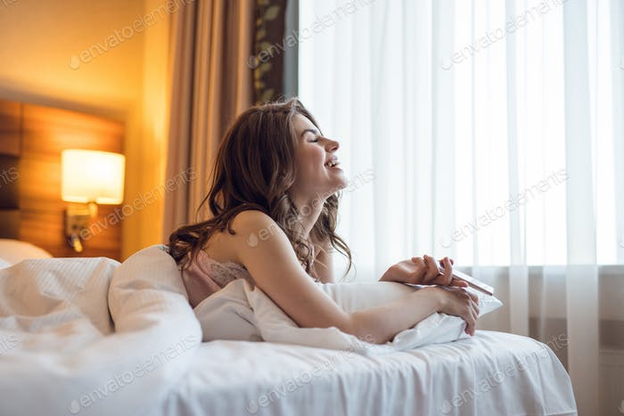 Smiling young girl in bed