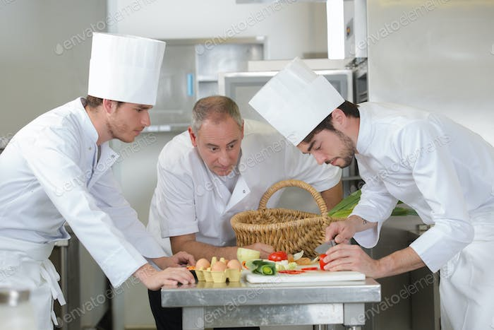 chef supervising trainees cooking