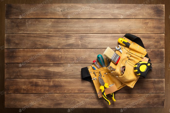 instruments in tool belt at wooden table