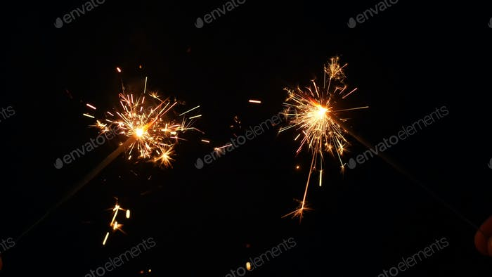 Sparkling stars burning  on black background. Movie suitable to satisfy celebrations and holidays.