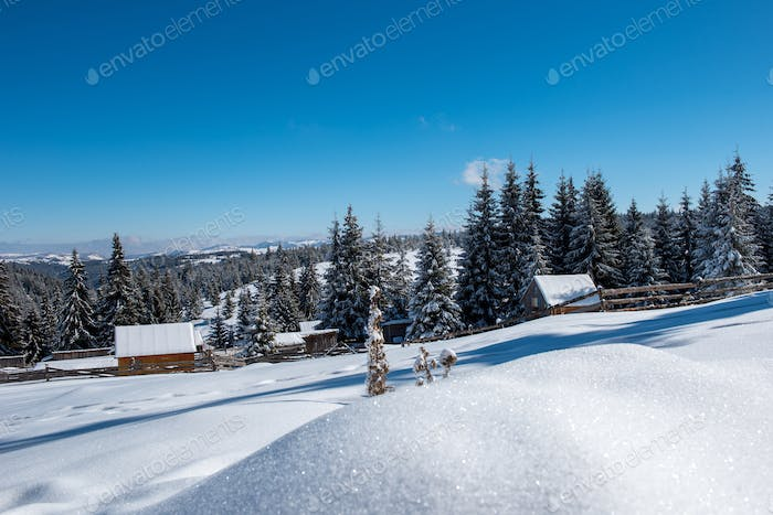 Idyllic winter wonderland mountain scenery with mountain chalet, lodge