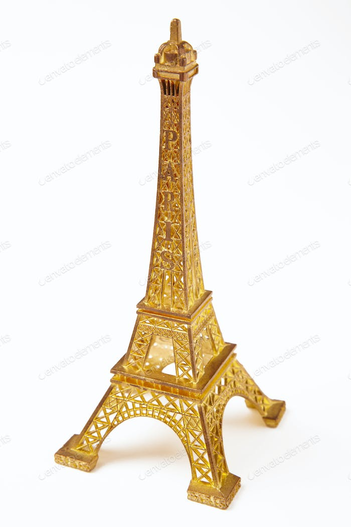 Eiffel tower souvenir detail isolated on white. France Paris tourism. Vertical