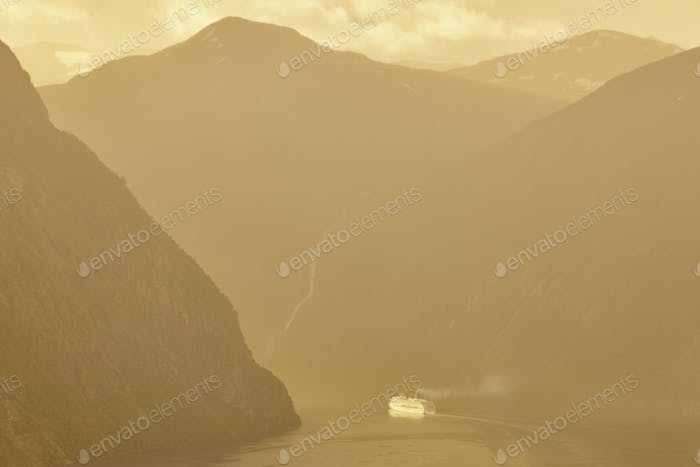 Norwegian fjord landscape at dawn. Cruise travel. Travel Norway tourism