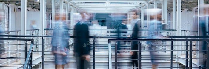 Business people talking in corridor