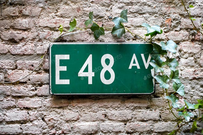 Road sign with E 48 av on green background