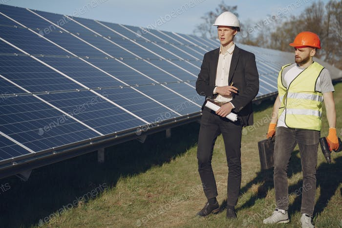 Foreman and businessman at solar energy station