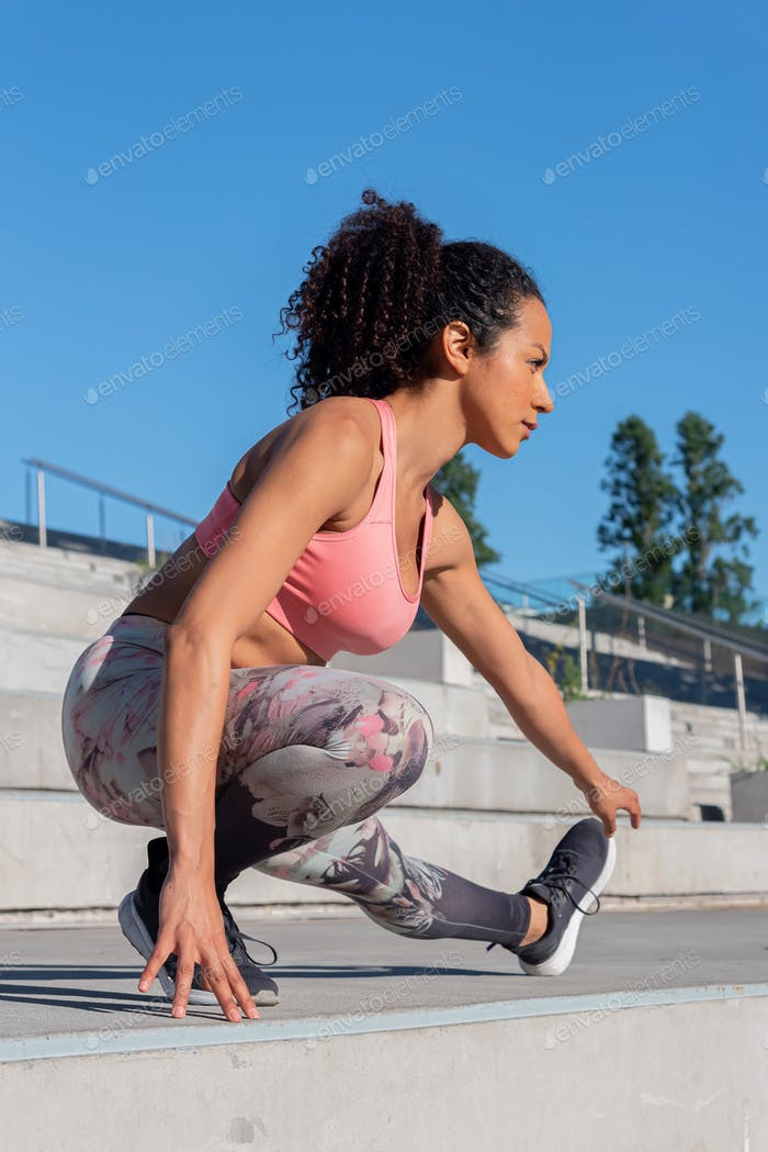 Latin American woman doing exercise outdoors