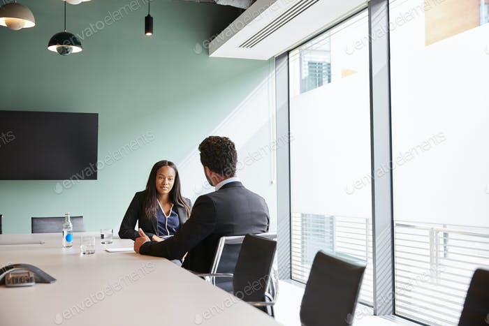Businessman Interviewing Female Candidate At Graduate Recruitment Assessment Day In Office