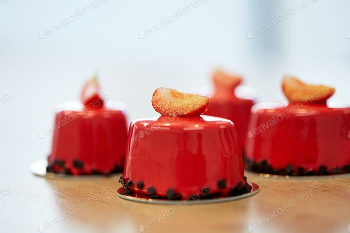 strawberry mirror glaze cakes at pastry shop