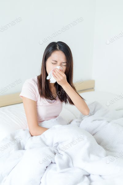 Woman with cold in bed