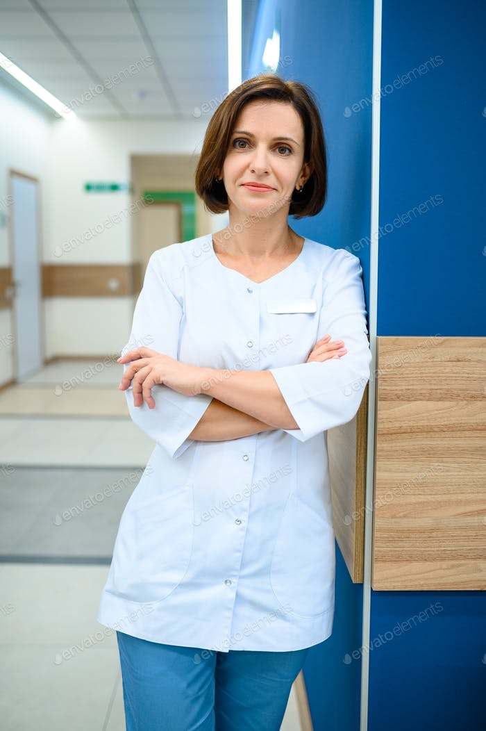 Female doctor standing in clinic corridor
