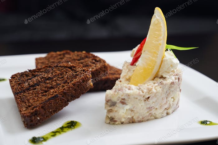 Salad with mayonnaise, grilled dark bread