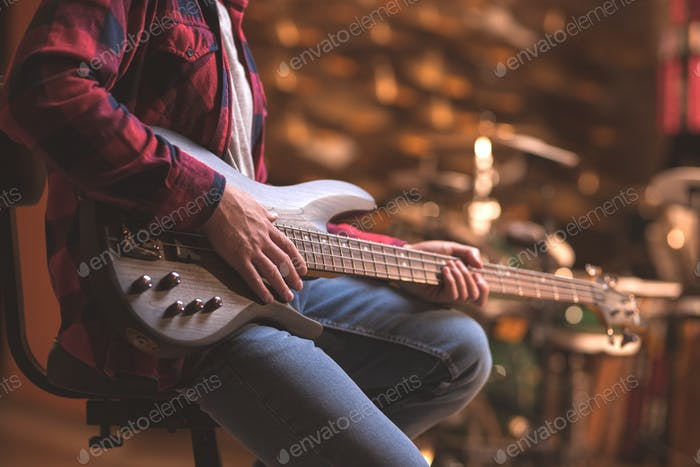 Young musician with bass guitar
