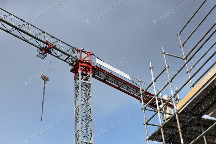 Crane and scaffold on construction site
