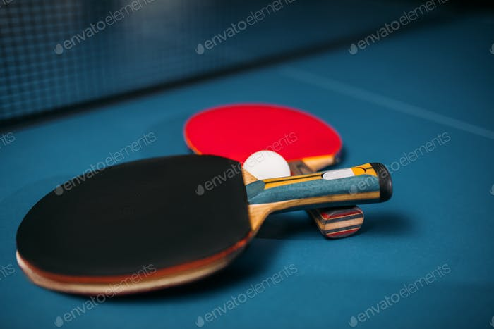 Tennis rackets and ball on the table, game concept