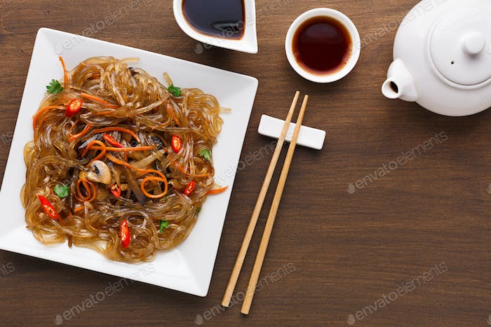 Served table with asian food in a bowl at rustic wooden background