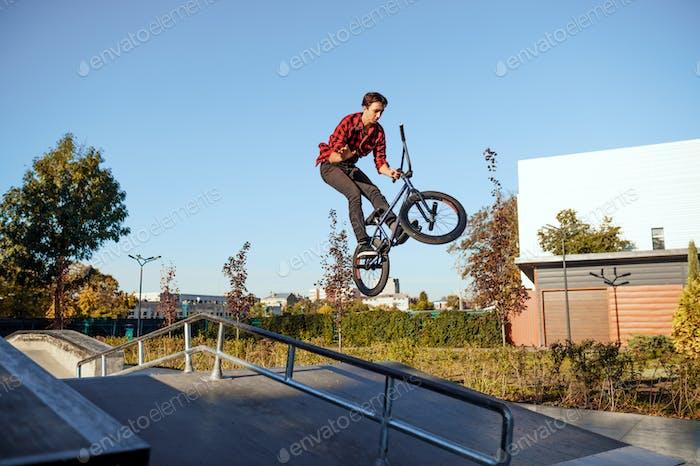 Male bmx biker, jump in action, skatepark