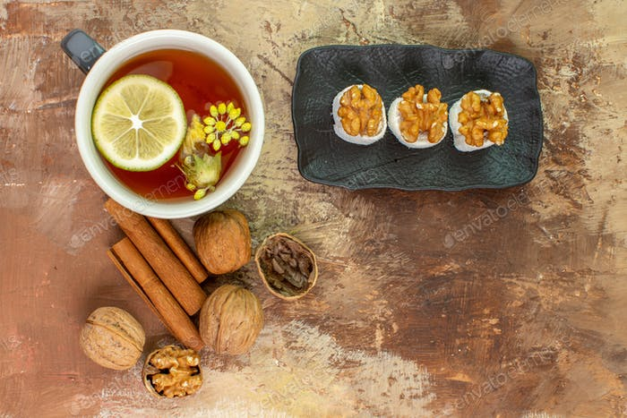 top view cup of tea with cinnamon and confitures on a light desk candy photo tea