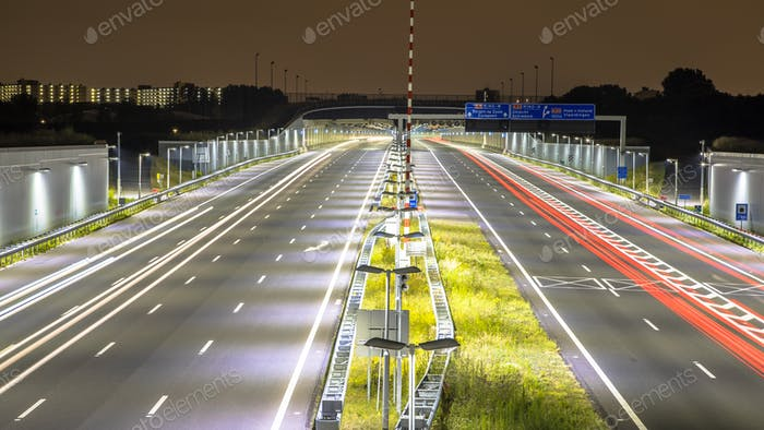 Motorway with tunnel at night