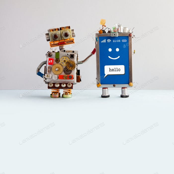 Robot and smiley mobile cellular gadget.