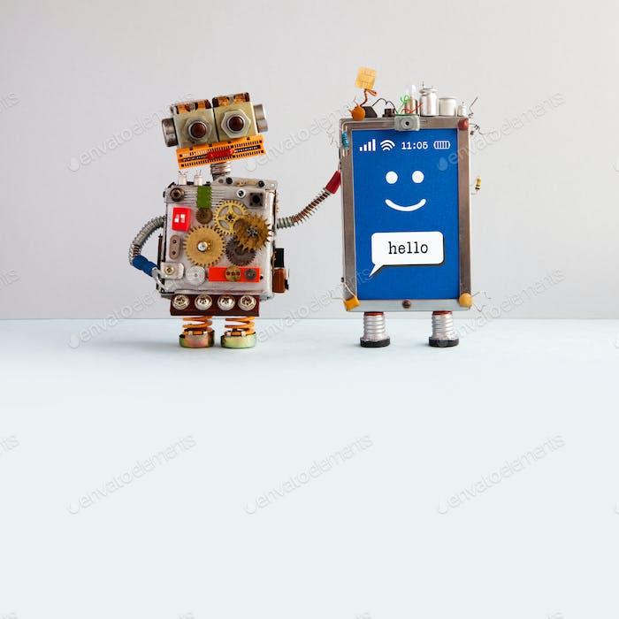 Робот и смайлик мобильный мобильный гаджет.