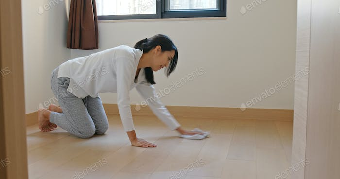 Asian Woman clean the floor at home prepare for lunar new year