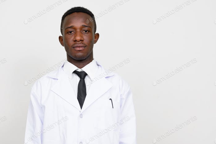 Portrait of young African man doctor looking at camera