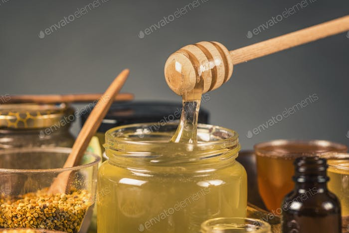 Honey Flowing into a Glass Jar