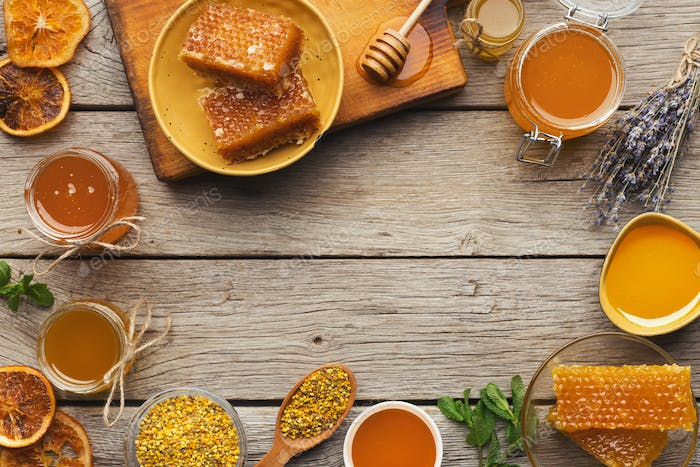 Various types of honey on old wooden background