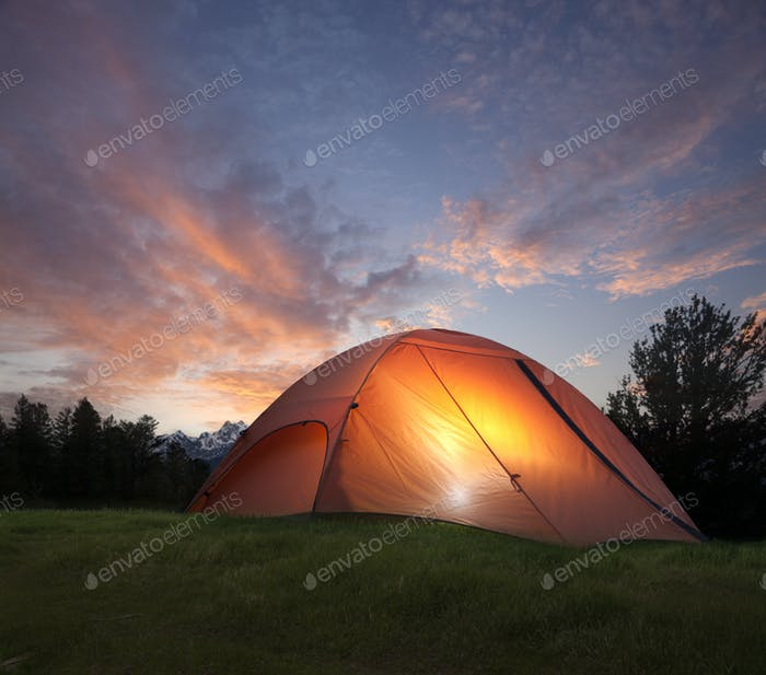 Orange Tent at Night with Mountains in Background