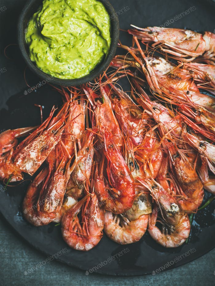 Roasted red shrimps with guacamole avocado sauce, top view