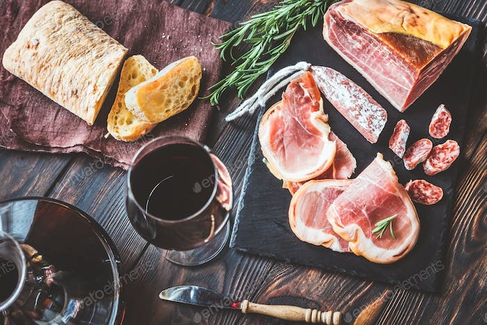 Red wine with prosciutto ham