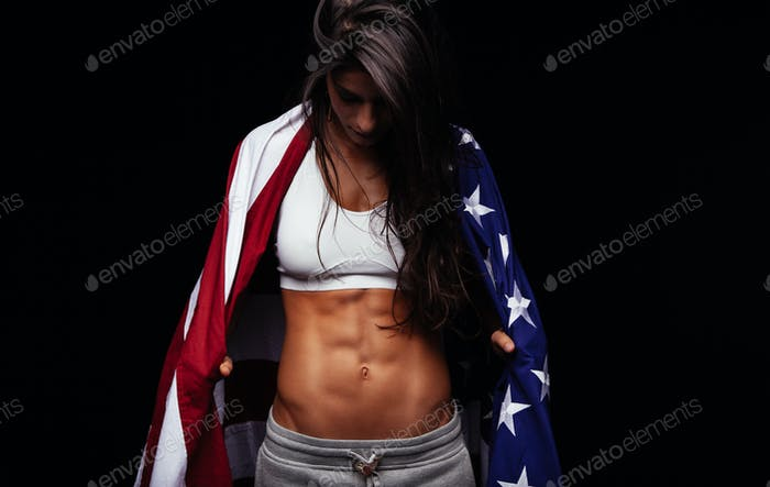 Female athlete carrying an American flag